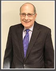Dr. John M. Haraldsen